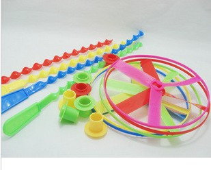 Urbanites hadnd ufo fly wheel around music classic toy plastic windmill